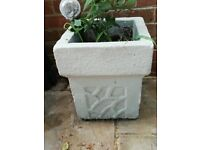 4 lovely solid stone pots for the garden painted with light grey weatherproof paint
