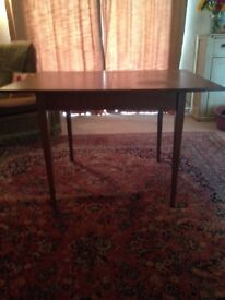 Solid wood dining table with flip out extension piece