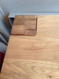 Next oak dining table slight crack in one of corners hence price