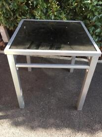 2 Sicily black glass and silver coffee tables.