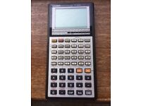 Vintage boxed Casio fx-7000G graphing calculator with soft case and manual