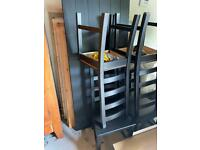 Black IKEA table with 4 chairs