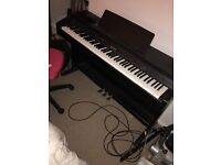 Black digital Celviano Model AP260 piano. Barely used. Good condition.