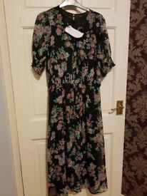 New black floral dress size 12
