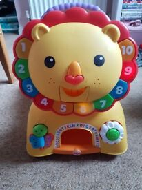 Fisher price sit and stride lion.