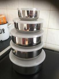 Set of Premium quality stainless steel lidded storage containers. In good clean condition.
