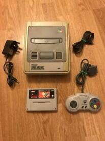 Nintendo SNES console with game.retro gaming