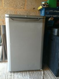 Indesit under counter fridge. Silver in colour.