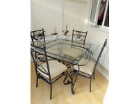 GLASS TABLE AND CHAIRS.