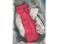 Bag full of newborn tiny baby clothes