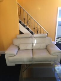 2 immaculate sofas cream leather......Cost £4000 new. £500 for both
