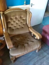 Two fantastic solid oak chairs with gold cushions.