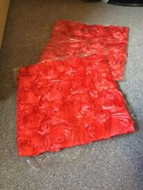 2 red cushion covers