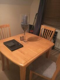 Extending solid table and chairs