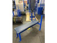 Flat bench with rack.