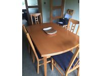 Ikea extending dining table & 6 chairs for sale. Photo shows it unextended. Good condition