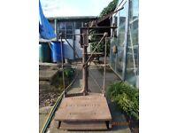 Vintage cast iron platform weighing scales.
