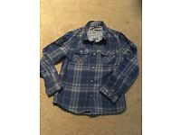 Boys long sleeved blue checked shirt age 7-8