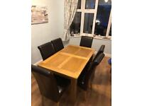 Solid oak dining table and chairs (extendable)