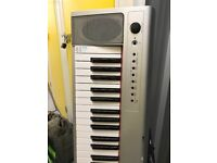 Yamaha Electric Keyboard with headphones