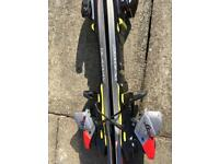 Retro Salomon ski bag with complete set of skis and ski poles