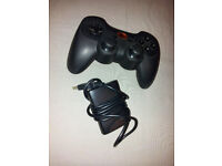 Two Logitech PC USB Game Controllers - Cordless Rumblepad 2, Dual Shock