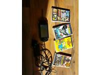 Sony psp with charger and 5 games working order vgc