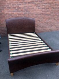 Brown faux leather double bed