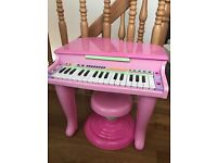 Kids pink piano with stool