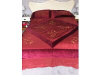 Maroon king size embroidered bed spread & matching pillow cases.