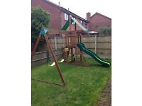 Children's garden activity set; includes wooden tower, climbing wall, swings and slide
