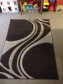 Brown swirl rug mat