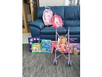 Assortment of kids books, bags and dolls pushchair