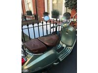 Retro Green Vespa LXV 125cc in great condition. One owner. MOT till March 2019