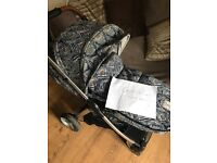 Armadillo flip xt in liberty with matching seat liner and footmuff