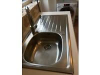 Stainless steel sink and mixer tap.