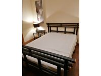 Double bed and side tables