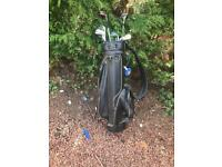 Black leather bag and golf clubs