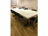 Large board room table with modern white acrylic top