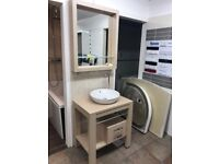 Vanity unit including the sink and matching mirror.