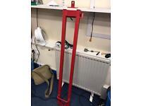Steel security bar for standard doorway