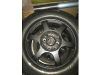 Black alloys with chrome dish 4 stud Vauxhall Astravan corsa