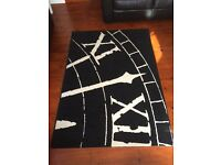 Black and white Art Deco clock rug