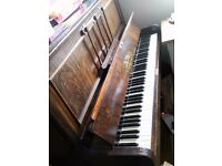Antique working upright piano