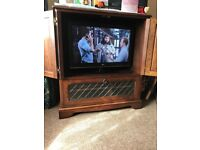 Solid oak television cabinet, very good condition.