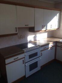 Cream kitchen with oak trim for sale