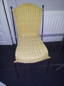 Black iron and rattan chair