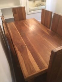 Next Indian solid hardwood table and 6 Chairs.