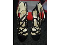 Black gladiator high heels, never worn! Needs to be gone soon as possible!