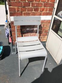 A set of 6 grey wrought iron chairs. A little bit rusted and very heavy.
